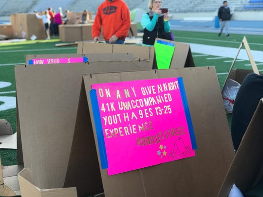 Participants at Reggie's Sleepout build their boxes to sleep overnight in on Nov. 2, 2019.