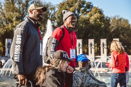 Former Detroit Lions receiver Herman Moore, clockwise from top left, with former left tackle Lomas Brown, World War II veteran Clarence Vaughn, 90, of Novi, and Vietnam War veteran David Moore, 69, of Lakeside, on Saturday, Nov. 2, 2019, in Washington.