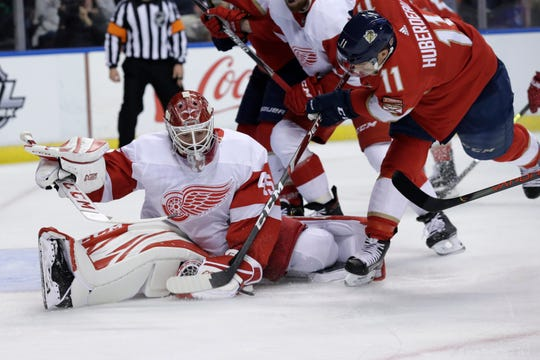 Red Wings goaltender Jonathan Bernier makes a save on a shot by Panthers center Jonathan Huberdeau during the second period Saturday.