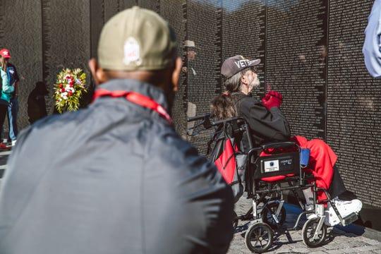 Former Detroit Lions receiver Herman Moore, left, watches as Vietnam veteran David Moore, 69, of Lakeside, visits the Vietnam Memorial in Washington on Saturday, Nov. 2, 2019.