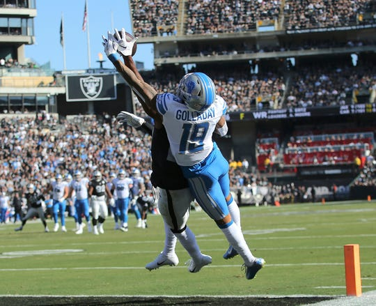 Raiders cornerback Daryl Worley, obscured, intercepts a pass intended for Lions wide receiver Kenny Golladay during the first half in Oakland, Calif., Sunday, Nov. 3, 2019.