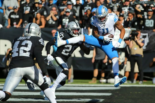 Marvin Jones catches a touchdown pass against the Raiders' Daryl Worley (20) and Karl Joseph during the first half.