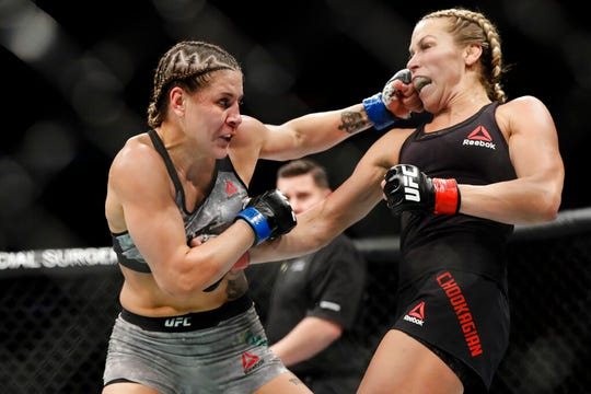 Brazil's Jennifer Maia, left, punches Katlyn Chookagian during the second round of a women's flyweight mixed martial arts bout at UFC 244, Saturday, Nov. 2, 2019, in New York. Chookagian won the fight.