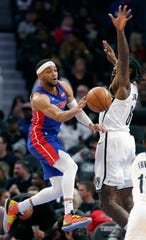 Detroit Pistons guard Bruce Brown (6) passes the ball against Brooklyn Nets center DeAndre Jordan (6) during the first half.