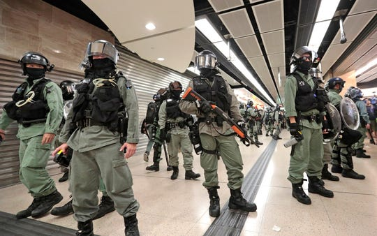 Riot police form a line at a shopping mall in Hong Kong, Sunday.