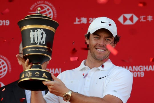Rory McIlroy raises the trophy after winning the HSBC Champions on Sunday.