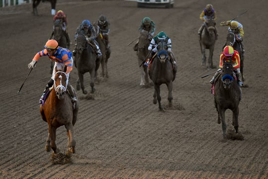 Irad Ortiz Jr., left, aboard Vino Rosso celebrates after winning the Breeders' Cup Classic.