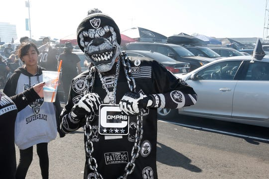 Raiders fans tailgate at RingCentral Coliseum before Sunday's game against the Lions.