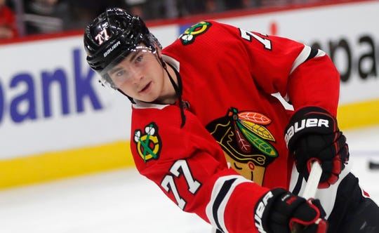 Blackhawks rookie Kirby Dach warms up before a game in Chicago on Oct. 22.