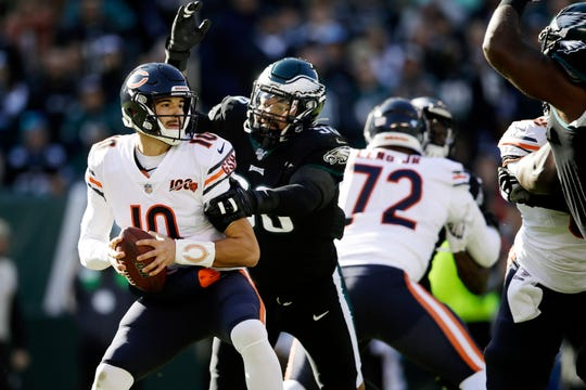 Bears quarterback Mitchell Trubisky (10) is tackled by Eagles' Derek Barnett (96) during the first half on Sunday.
