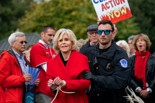 In this Friday, Oct. 25, 2019, file photo, actress and activist Jane Fonda is arrested at the Capitol for blocking the street after she and other demonstrators called on Congress for action to address climate change, in Washington. Fonda spent a night in a Washington, D.C., jail after her fourth arrest in as many weeks during a climate change demonstration on Capitol Hill. The 81-year-old Oscar winner was among more than 40 people arrested Friday, Nov. 1, while sitting inside a Senate office building.