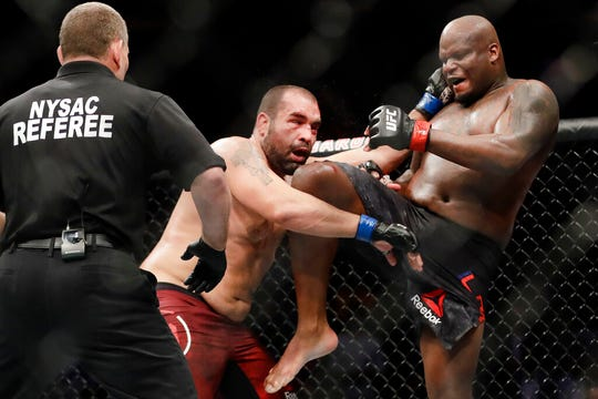 Derrick Lewis, right, delivers a knee to Bulgaria's Blagoy Ivanov during the third round of a heavyweight mixed martial arts bout at UFC 244, Saturday, Nov. 2, 2019, in New York. Lewis won the fight.