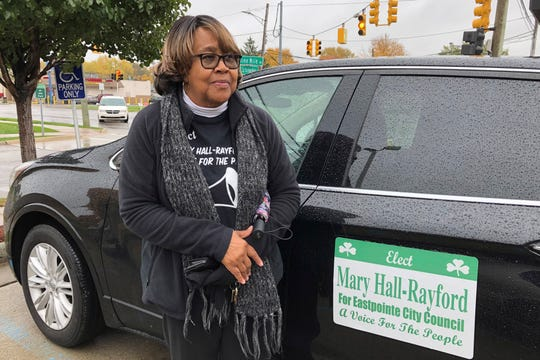 """Mary Hall-Rayford, a candidate for city council in Eastpointe stands next to her car. Eastpointe voters on Nov. 5 will elect two people to the council through an unusual election method called """"ranked-choice voting."""""""