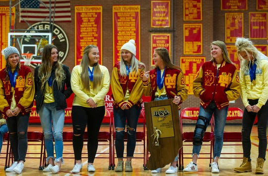 All seven seniors on the Mater Dei girls soccer team stand to be honored for their state championship win at Mater Dei High School in Evansville, Sunday afternoon.