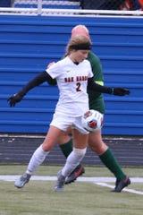 Oak Harbor's Hannah Schulte gains control.