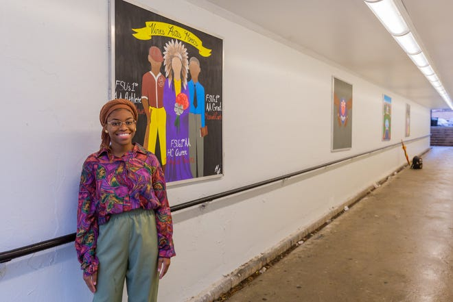 "Myah Freeman stands next to a rendition of Florida State University's Integration Statue. It's one of six ""mini murals"" that now hang in the revitalized Degraff tunnel. Tuesday, Oct. 29, 2019."