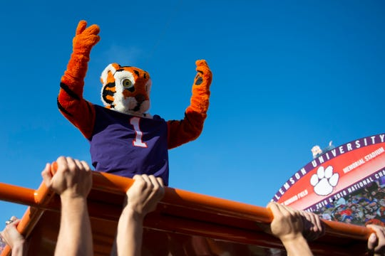 Clemson ROTC members lift the Clemson mascot up to perform push-ups after the football teamed scored the game against Wofford at Memorial Stadium in Clemson Saturday, November 2, 2019.