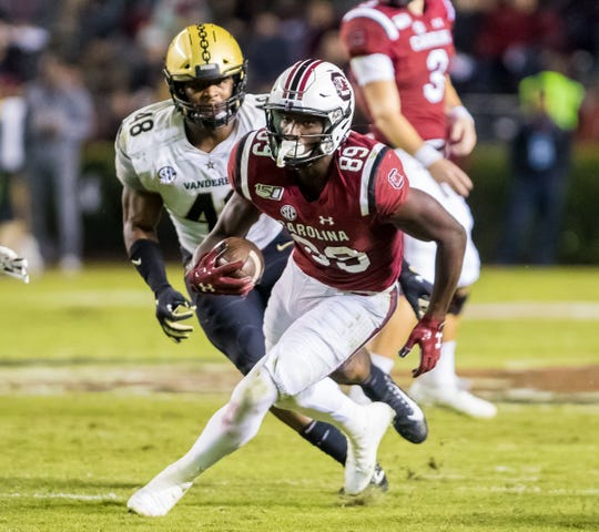 South Carolina wide receiver Bryan Edwards (89) carries the ball against the Vanderbilt Commodores at Williams-Brice Stadium Saturday night in Columbia.