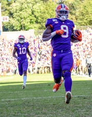 Clemson running back Travis Etienne (9) runs 47-yards for a touchdown during the first quarter at Memorial Stadium  in Clemson, South Carolina Saturday, November 2, 2019.