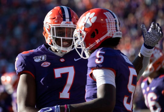 Clemson quarterback Chase Brice (7) and Clemson wide receiver Tee Higgins (5) celebrate Higgins' touchdown during the game against Wofford at Memorial Stadium in Clemson Saturday, November 2, 2019.