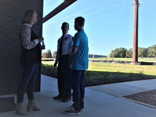 From left, Jackie McCall, Clear Springs Fire Rescue Chief Mike Huppmann and Ben McCall talk Sunday, Nov. 3, 2019, on the one-year anniversary of Ben's survival of a catastrophic bike crash on Woodruff Road. Jackie McCall said her husband defied the odds by regaining use of his arms and being able to walk within a few months after the accident, which happened Oct. 15, 2018.
