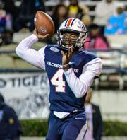 Jackson State quarterback Jalon Jones (4) looks to make a pass during the first half against Arkansas-Pine Bluff University Saturday, Nov. 2, 2019 in Jackson, Miss. (Cam Boneli/Hattiesburg American via AP).