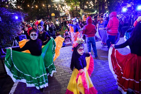 Dancer entertain at Henderson's first Día de los Muertos or Day of the Dead held in Central Park Saturday afternoon. The vibrant Mexican holiday celebrates the lives of those who have passed on through food, drink and celebration, November 2, 2019.