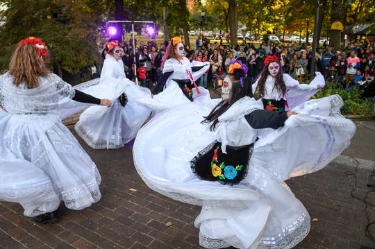 Dancers swirl at Henderson's first Día de los Muertos or Day of the Dead held in Central Park Saturday afternoon. The vibrant Mexican holiday celebrates the lives of those who have passed on through food, drink and celebration, November 2, 2019.