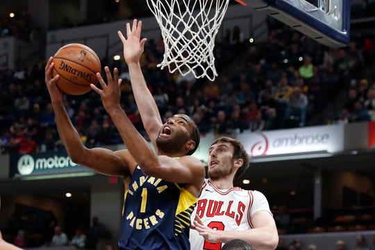 Nov 3, 2019; Indianapolis, IN, USA; Indiana Pacers forward T.J. Warren (1) takes a shot against Chicago Bulls forward Luke Kornet (2) during the first quarter at Bankers Life Fieldhouse.