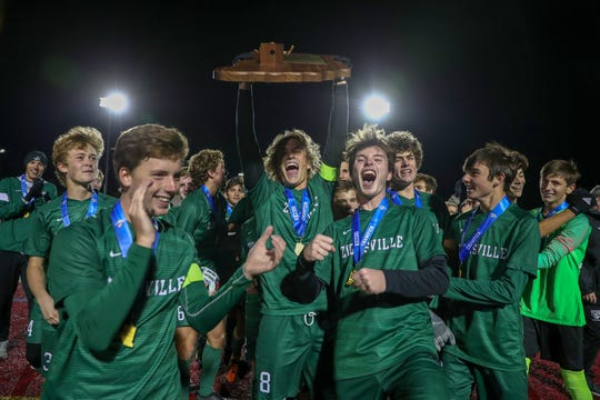 The Zionsville Eagles' boys soccer team celebrates their IHSAA Class 3A state championship after defeating the Lake Central Indians at Fishers High School on Saturday, Nov. 2, 2019.
