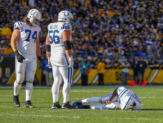 Indianapolis Colts quarterback Jacoby Brissett (7) lays on the ground after getting stepped on by teammate offensive guard Quenton Nelson (56) during a pass play against the Pittsburgh Steelers at Heinz Field in Pittsburgh, Pa., on Sunday, Nov. 3, 2019.