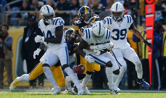 Parris Campbell (15) of the Indianapolis Colts fumbles the ball on a kick return, but it was held onto by Zach Pascal (14) of the Indianapolis Colts, Colts at Heinz Field, Pittsburgh, Sunday, Nov. 3, 2019. Colts lost 24-26.