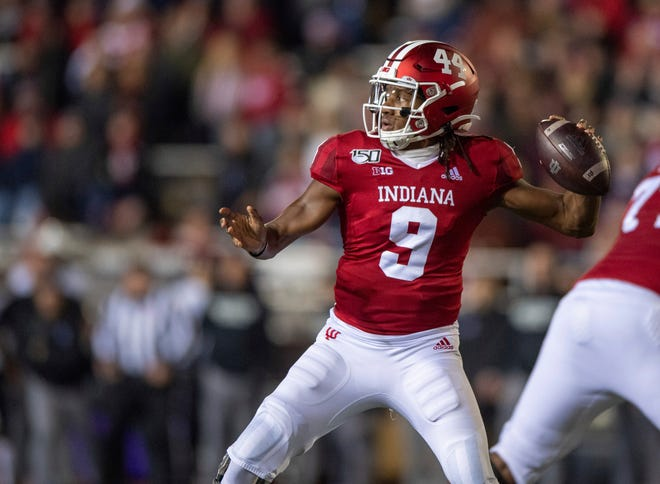 Indiana quarterback Michael Penix Jr. (9) dropped back to pass during the first half against Northwestern, , Nov. 2, 2019, in Bloomington, Indiana. The lost spring practices cost him time to continue to build his leadership.