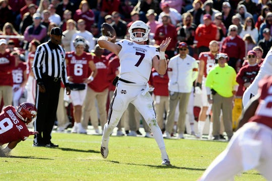Mississippi State quarterback Tommy Stevens throws a touchdown pass against Arkansas during the first half of an NCAA college football game, Saturday, Nov. 2, 2019 in Fayetteville, Ark.
