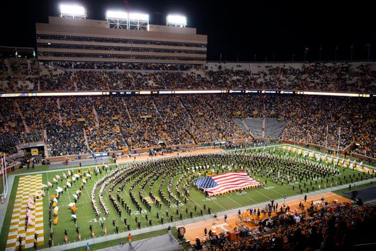 Lee Greenwood performs alongside The Pride of the Southland Band and Alumni Band at halftime during a game between Tennessee and UAB at Neyland Stadium in Knoxville, Tenn. on Saturday, Nov. 2, 2019.
