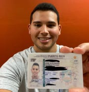 Jose Guzman Payano shows his Puerto Rico driver's license, which says was rejected for a cold medicine purchase at a CVS store in West Lafayette, across the street from the Purdue University campus, where he is a junior engineering student. CVS officials say the company is looking into the incident and that IDs from Puerto Rico, a U.S. territory, are accepted in the pharmacy chain's stores.
