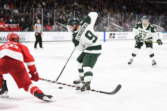 Michigan State forward Mitch Lewandowski fights to tip a puck in front of the net in MSU's 6-2 loss to Cornell on Saturday, November 2 at Munn Ice Arena