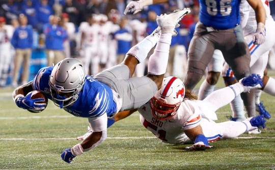 Memphis running back Kenneth Gainwell dives forward for extra yards against SMU at the Liberty Bowl Memorial Stadium on Saturday, Nov. 2, 2019.