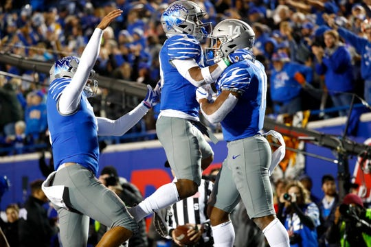 Memphis wide receiver Antonio Gibson (14) celebrates his touchdown reception with Kenneth Gainwell (19) and Brady White (3) against SMU on Saturday.
