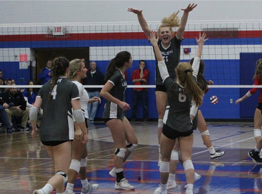 St. Thomas More's Jenna Flayter, the Metro Classic player of the year, celebrates a point during the sectional final against Wisconsin Lutheran.