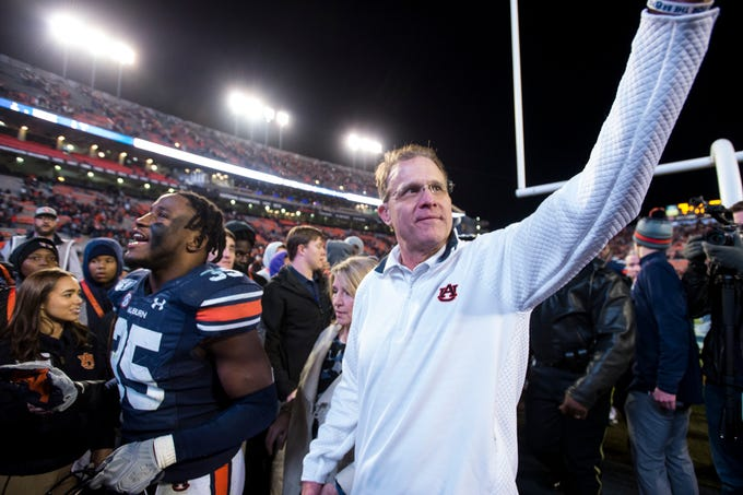 Auburn head coach Gus Malzahn waves to fans as he walks off the field at Jordan-Hare Stadium in Auburn, Ala., on Saturday, Nov. 2, 2019. Auburn defeated Ole Miss 20-14.