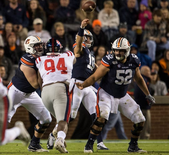 Auburn offensive lineman Nick Brahms (52) protects quarterback Bo Nix (10) as he throws the ball at Jordan-Hare Stadium in Auburn, Ala., on Saturday, Nov. 2, 2019. Auburn defeated Ole Miss 20-14.