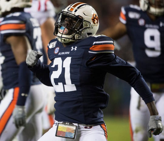 Auburn defensive back Smoke Monday (21) reacts after making a stop in the backfield at Jordan-Hare Stadium in Auburn, Ala., on Saturday, Nov. 2, 2019. Auburn leads Ole Miss 10-7 at halftime.