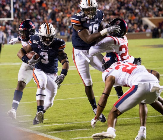 Auburn running back DJ Williams (3) runs down the sideline at Jordan-Hare Stadium in Auburn, Ala., on Saturday, Nov. 2, 2019.