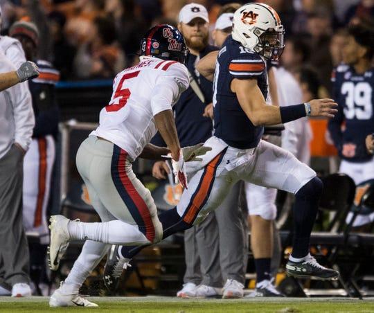 Auburn quarterback Bo Nix (10) runs the ball at Jordan-Hare Stadium in Auburn, Ala., on Saturday, Nov. 2, 2019. Auburn defeated Ole Miss 20-14.