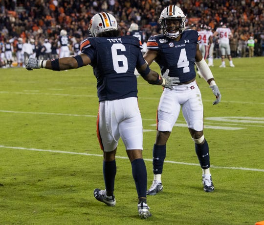Auburn defensive back Christian Tutt (6) and Auburn defensive back Noah Igbinoghene (4) celebrate a stop on the final drive at Jordan-Hare Stadium in Auburn, Ala., on Saturday, Nov. 2, 2019. Auburn defeated Ole Miss 20-14.