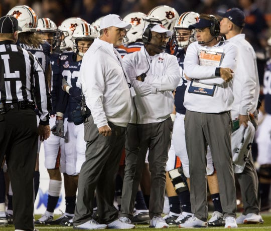 Auburn head coach Gus Malzahn talks with his staff during a timeout at Jordan-Hare Stadium in Auburn, Ala., on Saturday, Nov. 2, 2019. Auburn defeated Ole Miss 20-14.