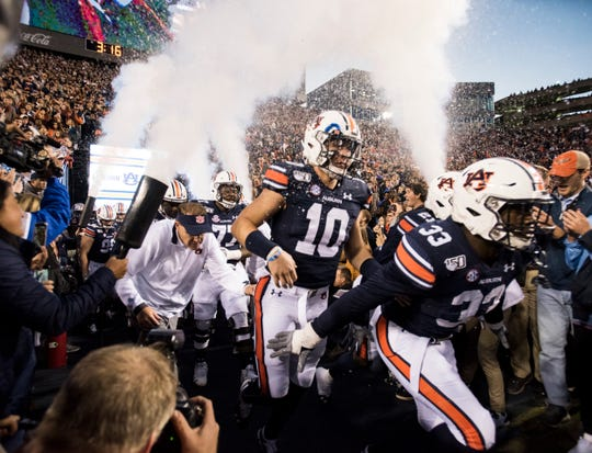Auburn quarterback Bo Nix (10) runs out with his team at Jordan-Hare Stadium in Auburn, Ala., on Saturday, Nov. 2, 2019.