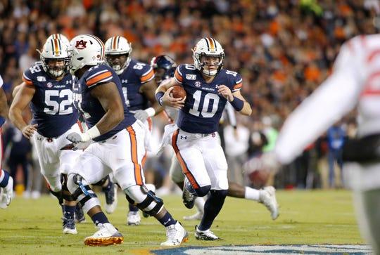 Auburn quarterback Bo Nix (10) carries against Ole Miss on Nov. 2, 2019, in Auburn, Ala.