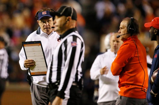 Auburn coach Gus Malzahn (left) and defensive coordinator Kevin Steele (right) during a game against Ole Miss at Jordan-Hare Stadium on Nov. 2. 2019.